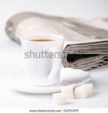 cup of coffee, sugar and stack of newspapers closeup - stock photo