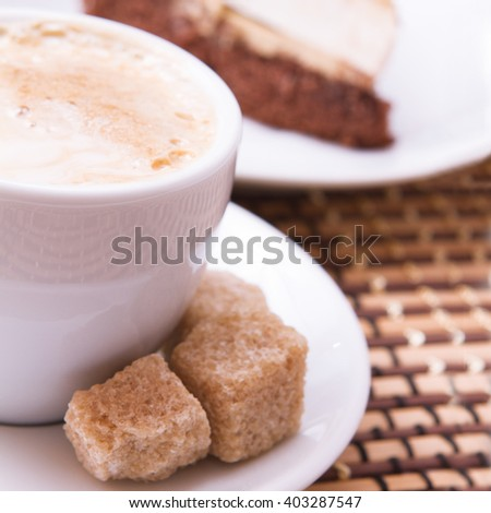 Cup of coffee, sweets, croissant and roasted beans square. Coffee concept. Selective focus. - stock photo