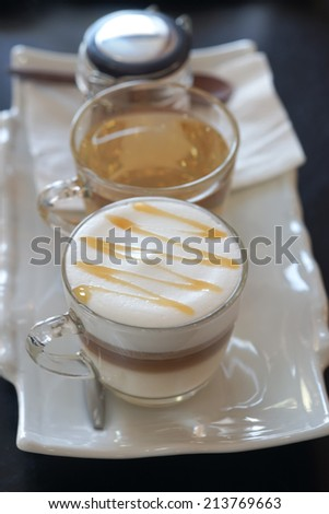 Cup of coffee, tea, and sugar bowl. - stock photo