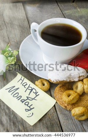 Cup of coffee (tea) with fresh cupcake,  Happy Monday massage on wooden background - stock photo