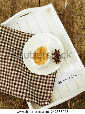 Cup of coffee with anise spices on the wooden table - stock photo