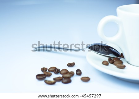 cup of coffee with beans on white background - stock photo