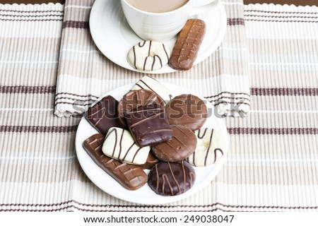 cup of coffee with chocolate biscuits - stock photo