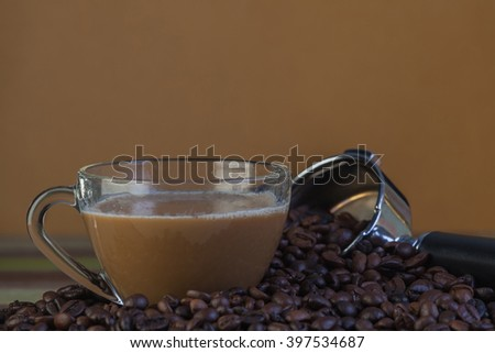 Cup of coffee with coffee beans, food and drink concept - stock photo