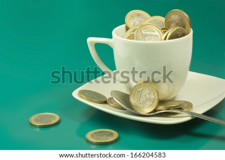 cup of coffee with coins of one euro - stock photo
