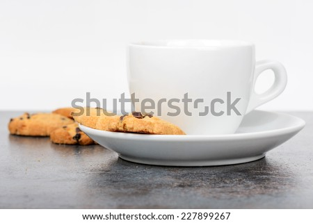 Cup of coffee with cookies on table - stock photo