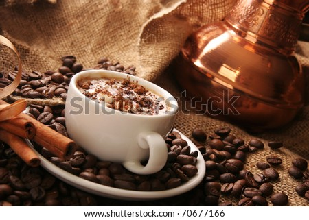 cup of coffee with cream and cinnamon - stock photo