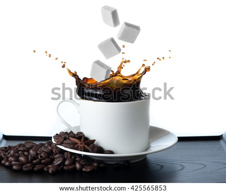 Cup of coffee with falling sugar cube  isolated on white background - stock photo
