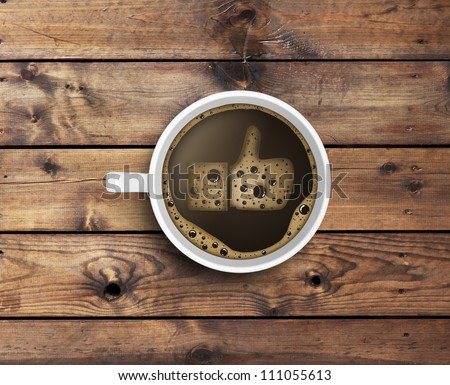 Cup of coffee with foam in like form. wooden texture - stock photo