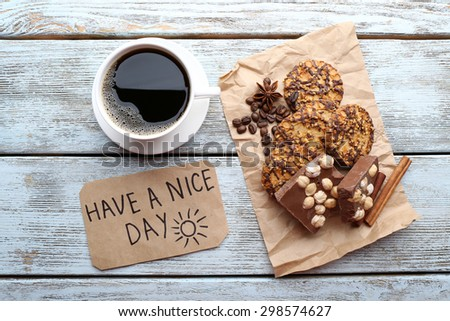 Cup of coffee with fresh croissant and Have A Nice Day massage on wooden table, top view - stock photo