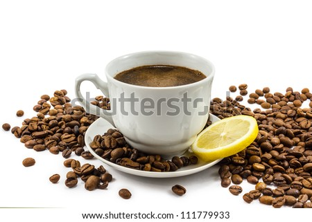 Cup of coffee with lemon and grains isolated on white - stock photo