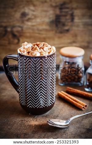 Cup of coffee with marshmallow and melted chocolate on wooden background. - stock photo