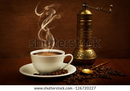 cup of coffee with oriental mill - stock photo