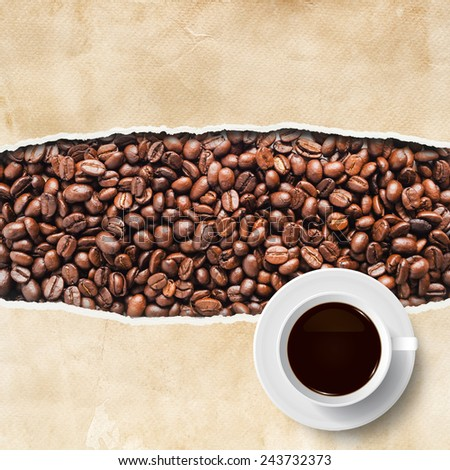 Cup of coffee with ripped vintage paper texture and coffee beans. - stock photo