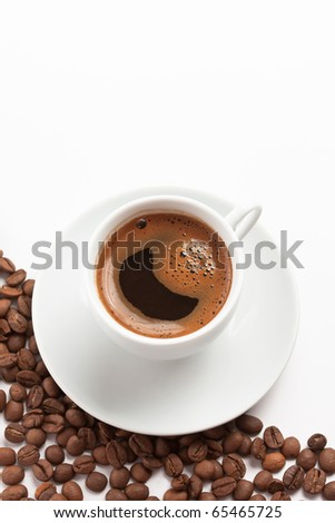 Cup of coffee with roasted coffee beans - stock photo