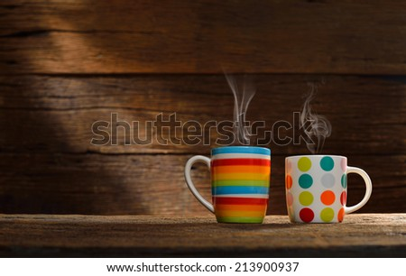 Cup of coffee with smoke on old wooden background - stock photo