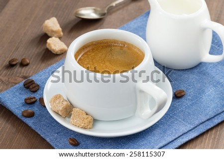 cup of coffee with sugar and milk jug - stock photo