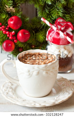 Cup of creamy hot chocolate with melted marshmallows for christmas holiday. - stock photo