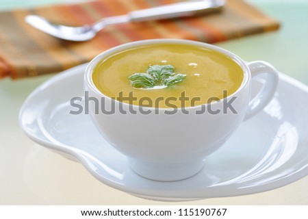 Cup of delicious homemade creamy squash soup. - stock photo