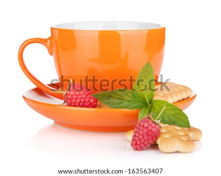 Cup of drink with crackers, mint and berries. Isolated on white background - stock photo