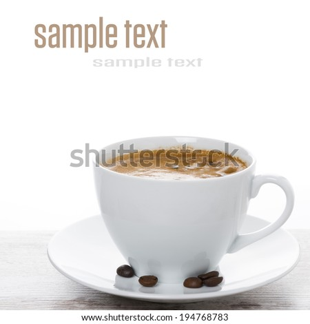 cup of espresso close-up on a white table and space for text, close-up - stock photo