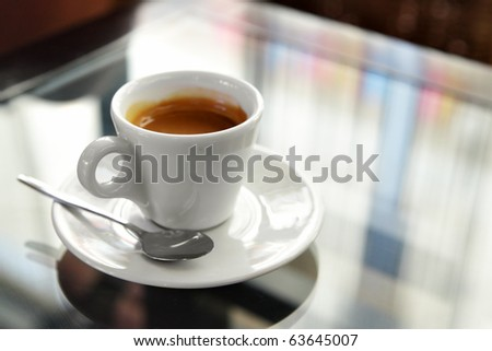 Cup of espresso coffee on the table - stock photo