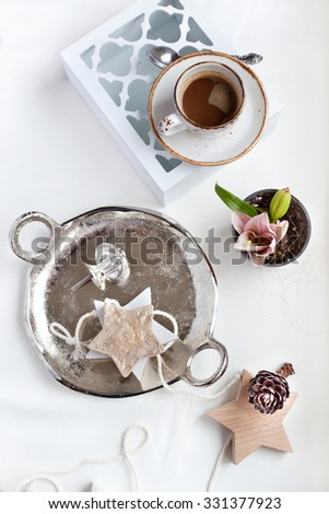 Cup of espresso coffee set with romantic style Christmas decorations and flowers. Natural light photo, shallow focus - stock photo