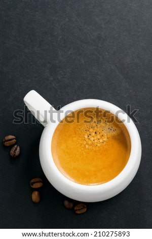 cup of espresso on a black background, top view, vertical - stock photo