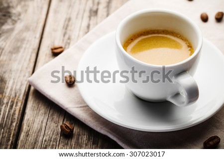 cup of espresso on textile tablecloth - stock photo