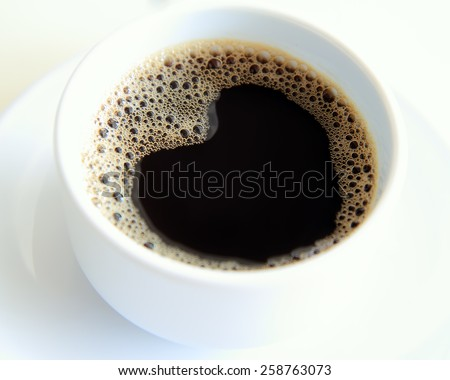 Cup of fresh coffee with heart sign - stock photo