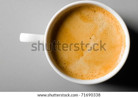 cup of fresh espresso coffee on table, view from above - stock photo