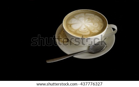 Cup of fresh hot coffee on dark background with copyspace - stock photo