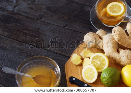 Cup of Ginger tea with lemon and honey on dark blue background - stock photo