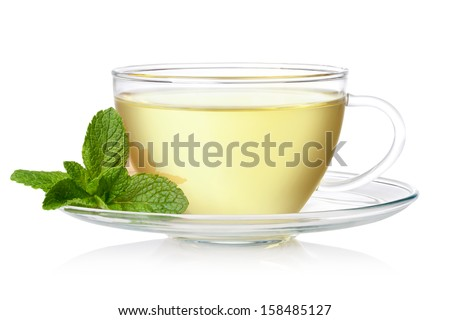 Cup of green tea with mint on a white background - stock photo