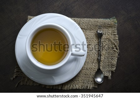 Cup of herbal tea on a wooden background,from above - stock photo
