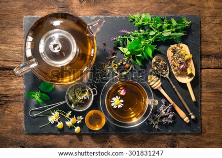 Cup of herbal tea with honey - stock photo