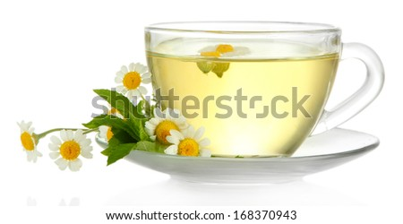 Cup of herbal tea with wild camomiles and mint, isolated on white - stock photo