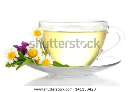 Cup of herbal tea with wild flowers and mint, isolated on white - stock photo