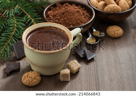 cup of hot chocolate and amaretti cookies on a wooden table, horizontal - stock photo