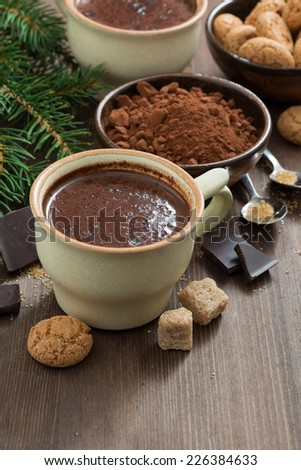 cup of hot chocolate and amaretti cookies on a wooden table, vertical, top view - stock photo