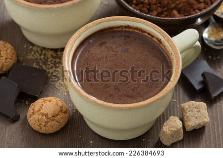 cup of hot chocolate and sugar cubes, top view, close-up - stock photo