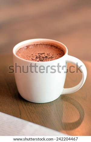 Cup of hot chocolate on the table - stock photo