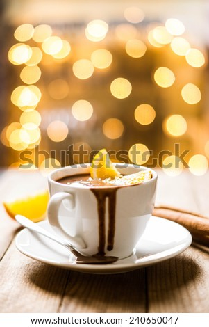 Cup of hot chocolate on the wooden table - stock photo