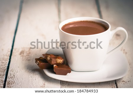 Cup of hot chocolate on wooden background - stock photo