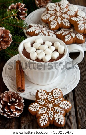 Cup of hot chocolate with marshmallows and gingerbread cookies on a wooden table - stock photo