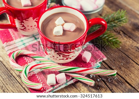 Cup of hot chocolate with marshmallows on a wooden table - stock photo