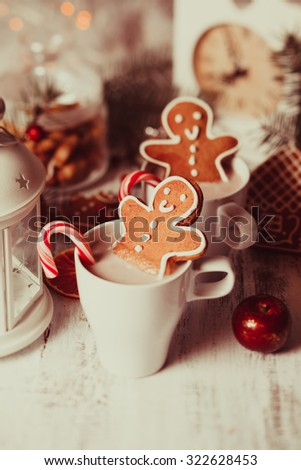 Cup of hot cocoa drink with cookie and candy. Christmas dessert - stock photo