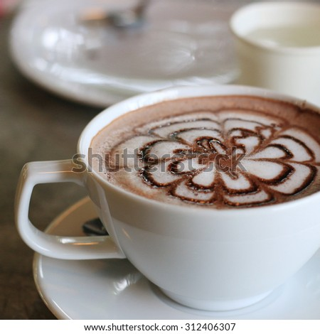 cup of hot cocoa on table - stock photo