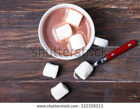 Cup of hot cocoa with marshmallows on the wooden table, top view - stock photo