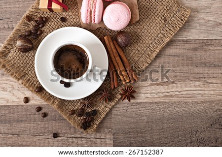 cup of hot coffee and spices, a gift wrap - stock photo